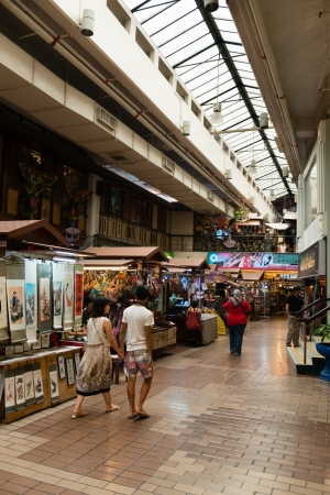 malaysia culture: KUALA LUMPUR - JUN 15: Customers and sellers in KL Central Market on Jun 15, 2013 in Kuala Lumpur, Malaysia. It is a landmark for Malaysian culture and heritage. Editorial