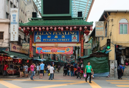bustling: KUALA LUMPUR - JUN 15: Gateway to Jalan Petaling in Chinatown on Jun 15, 2013 in Kuala Lumpur, Malaysia. It is famous tourist place with bustling market and crowded cafes. Editorial
