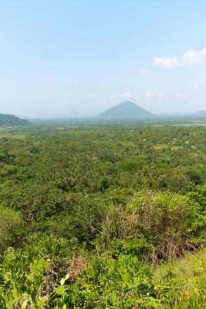 eminence: Tropical landscape with hill and mountain under blue sky, Dambulla, Sri Lanka