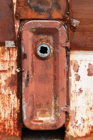 chernobyl: Rusty closed door on metal wall of wrecked abandoned ship