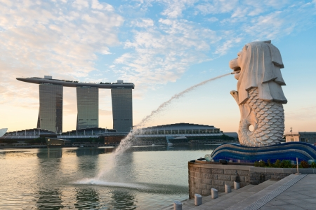 Singapore center with Merlion and skyscrapers at early morning