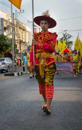 PHUKET, THAILAND - 07 FEB 2014: Phuket town residents take part in procession parade of annual old Phuket town festival.
