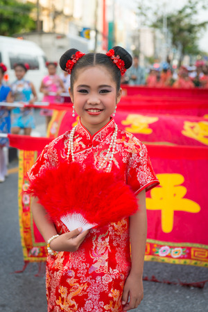 PHUKET, THAILAND - 07 FEB 2014: Beautiful girl take part in procession parade of annual old Phuket town festival.