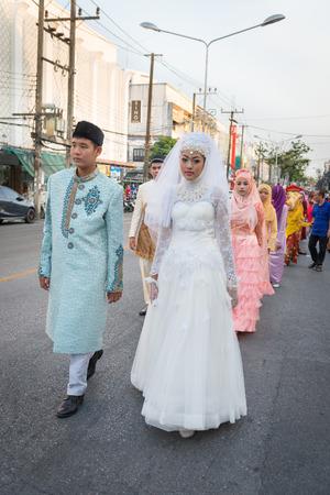 wedding parade: PHUKET, THAILAND - 07 FEB 2014: Phuket town residents in muslim wedding dress take part in procession parade of annual old Phuket town festival.