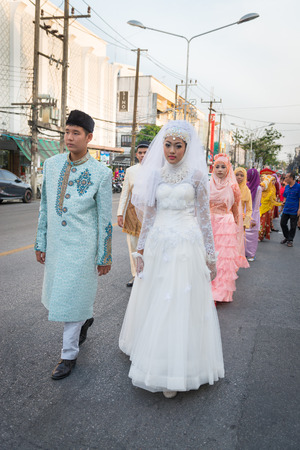 PHUKET, THAILAND - 07 FEB 2014: Phuket town residents in muslim wedding dress take part in procession parade of annual old Phuket town festival.