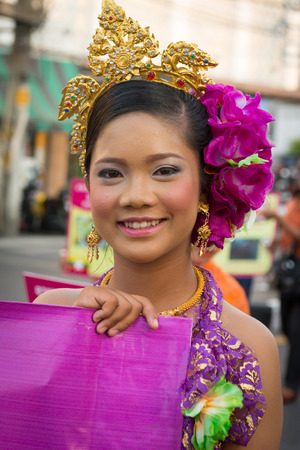 PHUKET, THAILAND - 07 FEB 2014: Beautiful girl takes part in procession parade of annual old Phuket town festival.