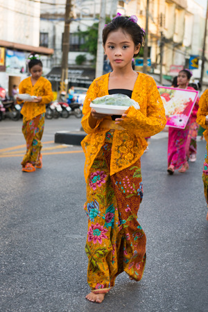 PHUKET, THAILAND - 07 FEB 2014: Young girl in traditional dress takes part in procession parade of annual old Phuket town festival.