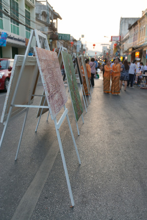 Street art exhibition and people walk on pedestrian street in asian town