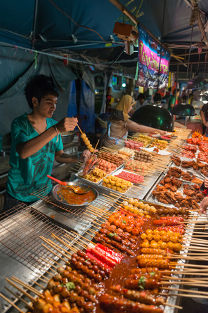 phuket food: PHUKET, THAILAND - 07 FEB 2014: Unidentified man sell food on street during annual old Phuket town festival.