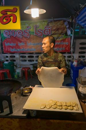 phuket food: PHUKET, THAILAND - 07 FEB 2014: Unidentified man cook food on street during annual old Phuket town festival.