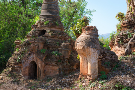 Ruins of lion statue in ancient Burmese Buddhist pagodas Nyaung Ohak in the village of Indein on Inlay Lake in Shan State, Myanmar (Burma). photo
