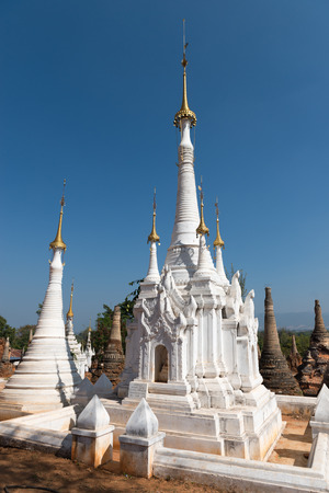 inlay: White ancient Burmese Buddhist pagodas Nyaung Ohak in the village of Indein on Inlay Lake in Shan State, Myanmar (Burma). Stock Photo