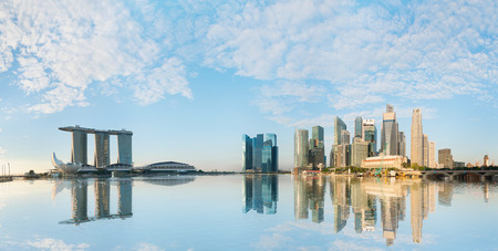 bay: Singapore skyline of business district with skyscrapers and Marina Bay Sands at morning under blue sky Editorial