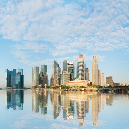 centre: Modern city skyline with skyscrapers buildings under blue sky at morning light, Singapore