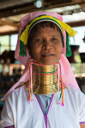 INLE LAKE, MYANMAR (BURMA) - 07 JAN 2014: Unidentified Padaung (Kayan Lahwi) tribe woman poses for a portrait. This tribe is called long neck€ because of metal rings around their necks.