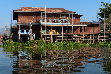 stilt house: Traditional stilts wooden and bamboo house of Intha people in water on Inle lake, Myanmar (Burma)