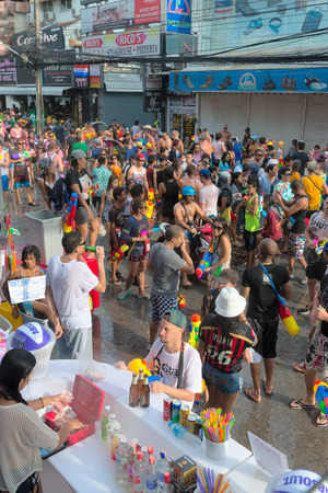 Phuket, Thailand - April 13, 2014: Tourists and residents celebrate Songkran Festival, the Thai New Year by splashing water to each others on Patong Bangla road.