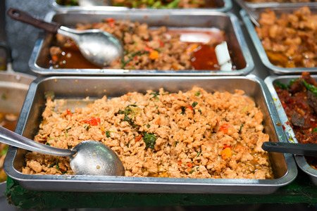 cafeteria tray: Metal tray with fresh minced cooked food on showcase at cafeteria. Stock Photo