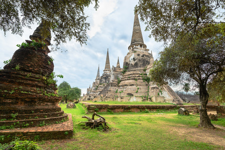 Ruins of ancient stupa chedis at Wat Phra Sri Sanphet Buddhist temple. Asian religious architecture in Ayutthaya, Thailand  photo