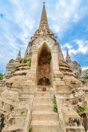 Ruins of ancient stupa chedi at Wat Phra Sri Sanphet Buddhist temple under blue sky. Asian religious architecture in Ayutthaya, Thailand  photo