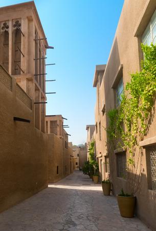 bastakiya: Tiny alleyways and wind towers in the old merchant quarter of Bastakiya in Dubai, United Arab Emirates. .