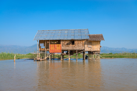 Traditional stilts wooden and bamboo house of Intha people in water on Inle lake, Myanmar (Burma)
