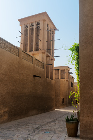 windtower: Tiny alleyways and wind towers in the old merchant quarter of Bastakiya in Dubai, United Arab Emirates. .
