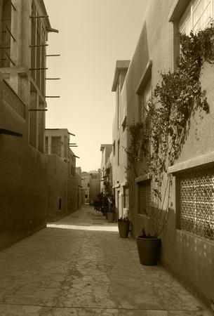 windtower: Tiny alleyways  in the old arabic merchant quarter of Bastakiya in Dubai, United Arab Emirates.