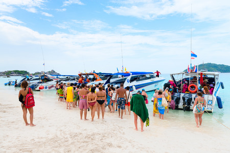 SIMILANS ISLANDS, THAILAND - MARCH 18, 2014: Tourists go on board the speed boat on the beach of Ko Miang island, Mu Ko Similan National Park