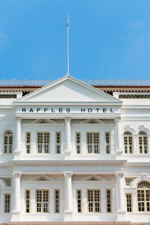 named: SINGAPORE - 02 JUN 2013: The Raffles Hotel in Singapore. Opened in 1899, it was named after Singapores founder Sir Stamford Raffles.