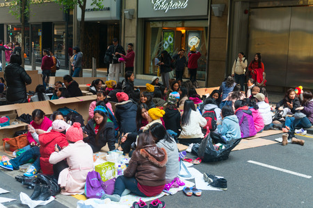 HONG KONG CHINA  18 JAN 2015: Meeting of mostly female Filipino workers on a street in downtown Hong Kong China. Editorial