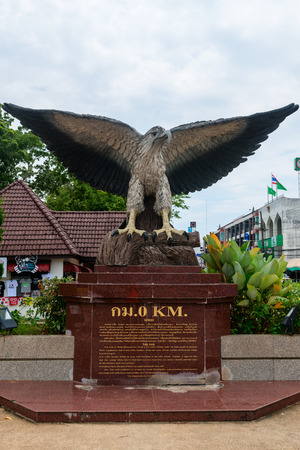 informational: KRABI THAILAND  14 OCT 2014: Large statue of a whitebreasted sea eagle with informational plaque prominently displayed at the beginning of a highway in Krabi Town Thailand.