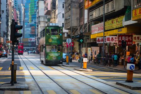 pubic: HONG KONG CHINA  18 JAN 2015: Electric trolleys and motor vehicles on a typical downtown street in Hong Kong China.