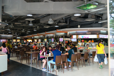 center court: SINGAPORE  31 DEC 2013: Modern food court at a major shopping center in Singapores urban center. Editorial