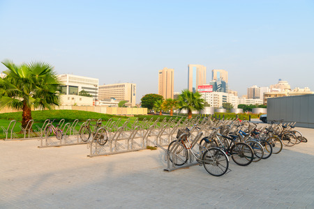 dozens: DUBAI UAE  16 JULY 2014: Bicycle racks provide a secure place to park dozens of bikes to encourage alternative transportation in this modern and progressive city. Editorial