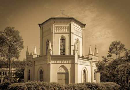 church building: Old church building in neoclassical style with stainedglass window in vintage sepia tone.