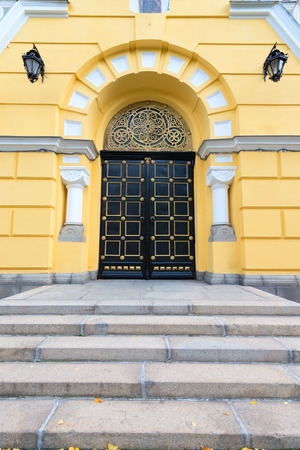 ornate door: Intricately decorated, ornate door and arched entryway to a beautiful, old building in downtown Kiev, Ukraine. Stock Photo