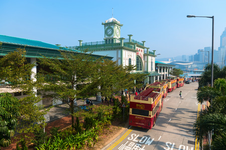 busses: HONG KONG, CHINA - 18 JAN 2015: Tourist Big busses near Central Ferry Pier. It is place to start sightseeing tours or travel by Hong Kongs famous Star Ferry.