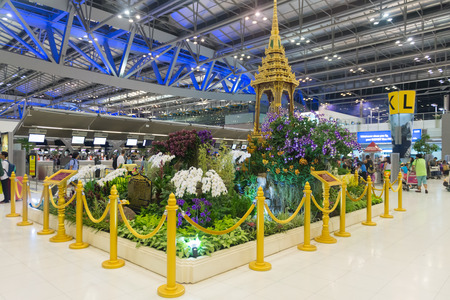 concourse: BANGKOK, THAILAND - 15 JULY 2014: Indoor garden display with gilded stanchions in the main concourse of Suvarnabhumi Airports passenger terminal. Editorial