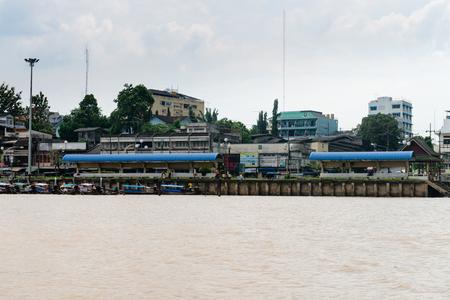 boat dock: KRABI, THAILAND - 14 OCT 2014: Shaded waiting benches along a passenger boat dock in Krabi, Thailand. Editorial