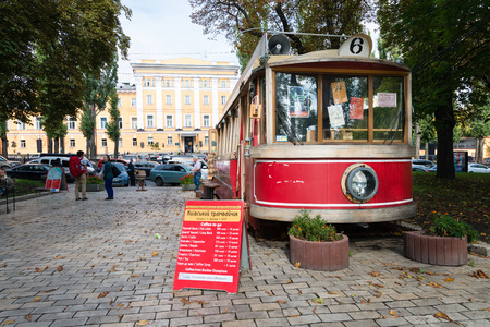 tree service pictures: KIEV, UKRAINE - 18 SEP 2013: Old, classic street car, converted into a café and operating inside Shevchenko Park in Kiev, Ukraine.