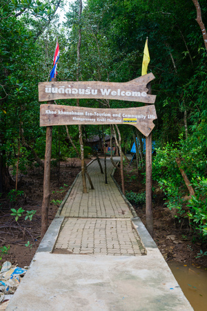 ecotourism: KRABI, THAILAND - 14 OCT 2014: Wooden welcome sign at Khao Khanabnam Ecotourism and Community Life Center, a popular tourist attraction in Krabi Thailand