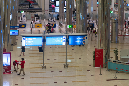 concourse: DUBAI, UAE - 16 JULY 2014: Overlooking view of a sparkling, clean concourse area, approaching the customs counters at Dubai International Airports main terminal. Editorial