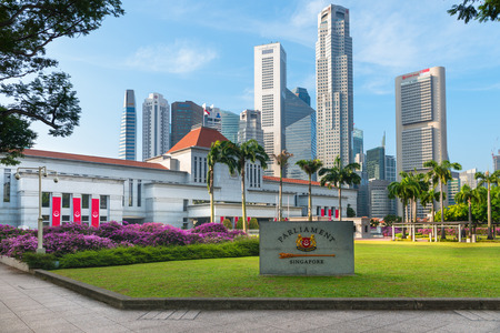singapore culture: SINGAPORE - 07 AUG 2015: Parliament House in downtown Singapore, with modern, commercial highrise buildings in the background.