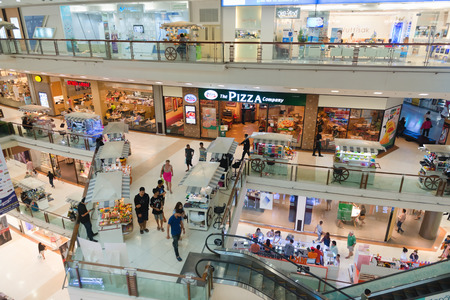 upper floor: PHUKET, THAILAND - 23 MAY 2014:  Looking out from the top floor, over the multiple levels of Central Festival Mall, one of the regions premier shopping destinations.