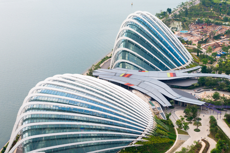 enormous: SINGAPORE - 07 AUG 2015: Enormous Domes of Gardens by the Bay in Singapore, two enormous greenhouses comprise a major part of this popular public park. Editorial