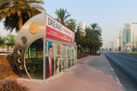 conditioned: DUBAI, UAE - 16 JULY 2014: Enclosed, air conditioned, city bus stop in downtown Dubai.