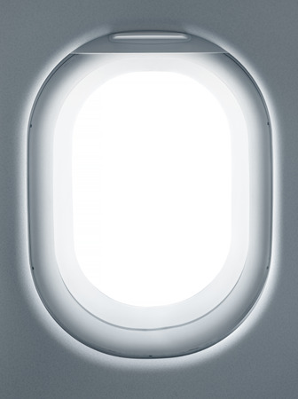 looking at view: Airplane window from interior of aircraft. Business travel template for your ideas of view through porthole with clipping path