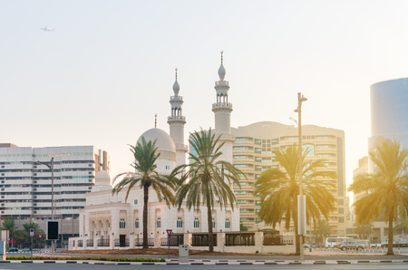 minarets: Beautiful mosque in a middle eastern, metropolitan city, with ornate and finely detailed minarets and domes. Stock Photo