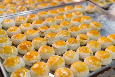 dozens: Dozens of hopia dough balls, arranged in rows on a bakers pan at a bakery in Southeast Asia. Stock Photo